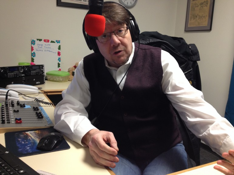 Drive Time radio host Dave Glover looking very snappy behind the microphone in his new waistcoat.