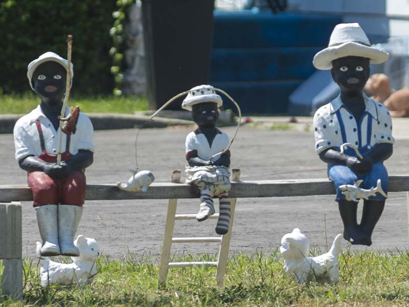 Statues of Black children fishing